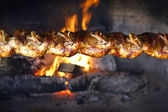 Roasted chickens on a bbq — Stock Photo