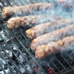 Hamburger patties on the grill — Stock Photo #38335479
