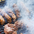 Hamburger patties on the grill — Stock Photo #38335493