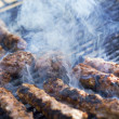 Hamburger patties on the grill — Stock Photo #38335581