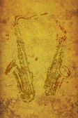 Vintage stamps of two saxophones on old paper. — Stock Photo