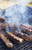 Hamburger patties on the grill — Stock Photo