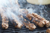 Hamburger patties on the grill — Stock Photo