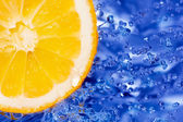 Fresh water splash on orange  — Stock Photo