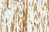 Background of white, peeling paint on an old wall  — Stock Photo