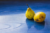 Pears on a blue table  — Stock Photo