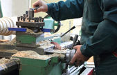 Man works in a lathe  — Photo