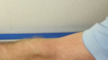 Applying Blue Painter's Tape — Stock Video