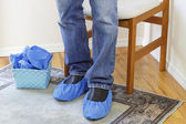 Standing Person Wearing Booties — Stock Photo