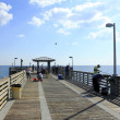Dania Beach Pier People Fishing - Stock Photo