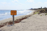 Caution Sign on Dania Beach — Stock Photo