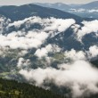Formation of clouds in the mountains after the rain - Stock Photo