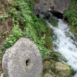 Stock Photo: Millstone and bridge