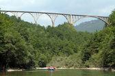 Bridge and boat — Stock Photo