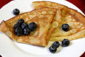 Crepes with berries — Stock Photo