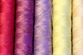 Multicolored sewing threads — Stock Photo