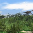 Gigantoraptor running on grass hill — Stock Photo #12172687