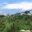 Stock Photo: Gigantoraptor running on grass hill