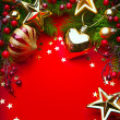 Art Christmas Decorations on red background — Stock Photo