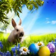 Art Little Easter bunny and Easter eggs on green grass — Stock Photo #21978977