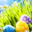 Stock Photo: Art easter eggs in flowers
