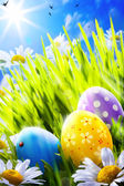 Art easter eggs in flowers — Stock Photo