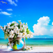 Art seascape and jasmine flowers — Stock Photo #26584259