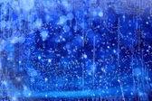 Sanat noel ışıkları mavi zemin üzerine — Stok fotoğraf