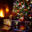 Stock Photo: Art Christmas Tree and Christmas gift boxes in interior with