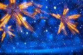 Konst julbelysningen på blå bakgrund — Stockfoto