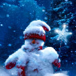 Christmas snowman and fir branches covered with snow — 图库照片
