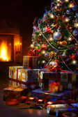Christmas Tree and Christmas gift boxes in the interior with a f — Stok fotoğraf