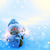 Art Christmas snowman and sparklers on blue snow background — Stock Photo