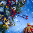 Art Christmas background with a red ornament, berries and fir in — Stok fotoğraf