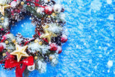 Art Christmas background with fir twigs and golden stars — Stock Photo