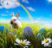 art easter bunny and easter egg on spring field — Stock Photo