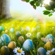 Stock Photo: Art decorated easter eggs in the grass with daisies
