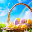 Art Easter eggs on basket — Stock Photo