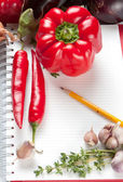 Blank notepad with ingredients for your recipe — Stock Photo