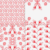 Illustration of four different floral patterns — Stock Vector