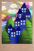 Sunset over a town in paper applique — Stock Photo