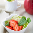 Freshly sliced strawberries, lime and mint — Stock Photo #37750697