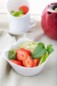 Freshly sliced strawberries, lime and mint — Stock Photo