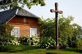 Country seat with wooden cross — Stock Photo
