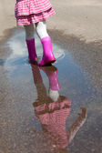 Girl in a puddle — Stock Photo