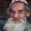 Nepalese oldman with dhaka topi — Stock Photo