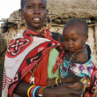 Stock Photo: KENYA, MASAI MAR- JANUARY 6: Mother holding her baby and stand