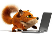 Fox using a laptop — Stock Photo