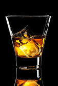 Whiskey glass with ice cubes — Stock Photo