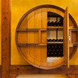 Wine barrel with wine bottles — Stock Photo
